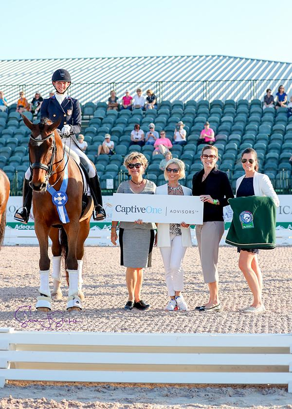 Laura Graves with judge at C Janet Foy (USA), Amanda S. Luby and Olga Harstock of sponsors CaptiveOne Advisors, and AGDF's Cora Causemann.