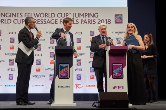 Sweden's Henrik von Eckermann (left) and French star Roger Yves Bost (right) pictured at the draw for starting order of the Longines FEI World Cup™ Jumping Final in Paris (FRA) tonight. Hosts for the night were Yannick Bichon (far left) and Alison Drummond (far right).
