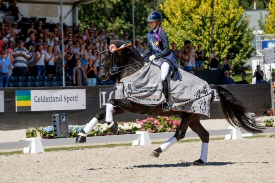 The fabulous black stallion, Glamourdale, nd British rider Charlotte Fry won the Seven-Year-Old Final for Great Britain's Charlotte Fry at the Longines FEI/WBFSH World Breeding Dressage Championships 2018 in Ermelo (NED). (FEI/Dirk Caremans)