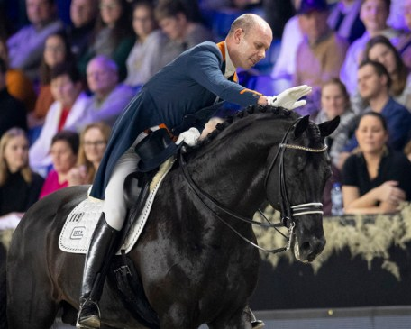"""""""That's my boy!"""" The Netherlands' Hans Peter Minderhoud congratulates his brilliant young stallion, the 10-year-old Glock's Dream Boy NOP, after the pair won today's exciting seventh leg of the FEI Dressage World Cup™ 2018/2019 Western European League in Mechelen, Belgium. (FEI/Dirk Caremans)"""