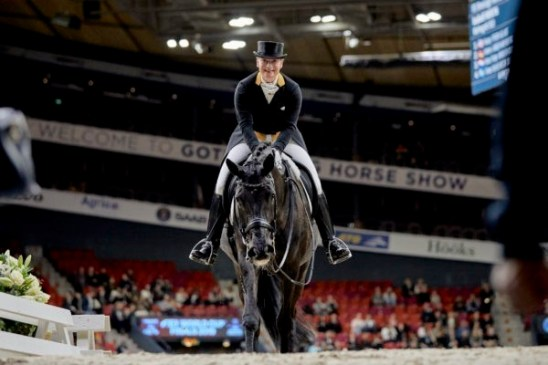 Happy ladies - defending double-champions, Germany's Isabell Werth and Weihegold OLD, leave the arena after posting the winning score in today's Grand Prix at the FEI Dressage World Cup™ Final 2019 in Gothenburg (SWE). (FEI/Liz Gregg)