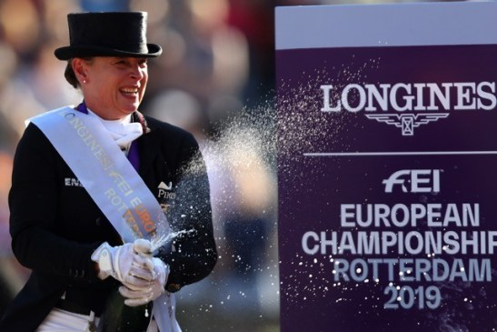 All fizzed up after the Freestyle - Germany's Isabell Werth celebrates her third gold medal of the week following today's Freestyle victory with Bella Rose at the Longines FEI Dressage European Championships 2019 in Rotterdam, The Netherlands. (FEI/Dean Mouhtaropoulos/Getty Images)