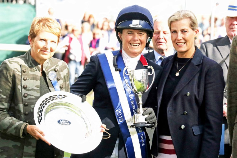 Pippa Funnell collecting the Land Rover Burghley Horse Trials Trophy. Image credit Mike Bain