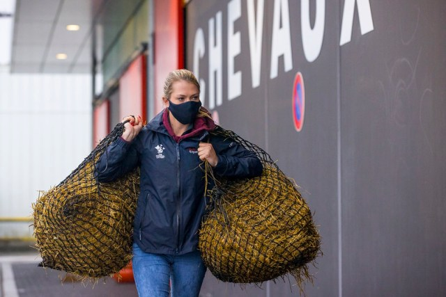 British athlete Charlotte Fry at Liege airport prepares for her horse's flight  Charlotte Fry unloading the truck Departure of the horses to the Olympic Games in Tokyo from Liege - Belgium 2021 © FEI/Leanjo de Koster