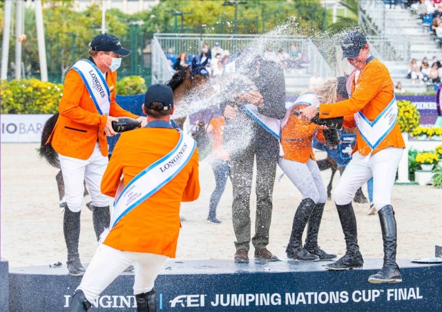 The Dutch team in celebration mood after their superb victory in the Longines FEI Jumping Nations Cup™ Final 2021 at the Real Club de Polo in Barcelona, Spain today. (FEI/Lukasz Kowalski)