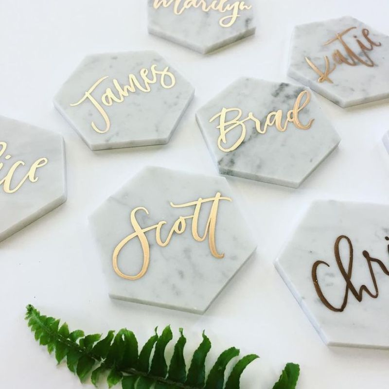 Carrara marble place holders by Twinkle and Toast