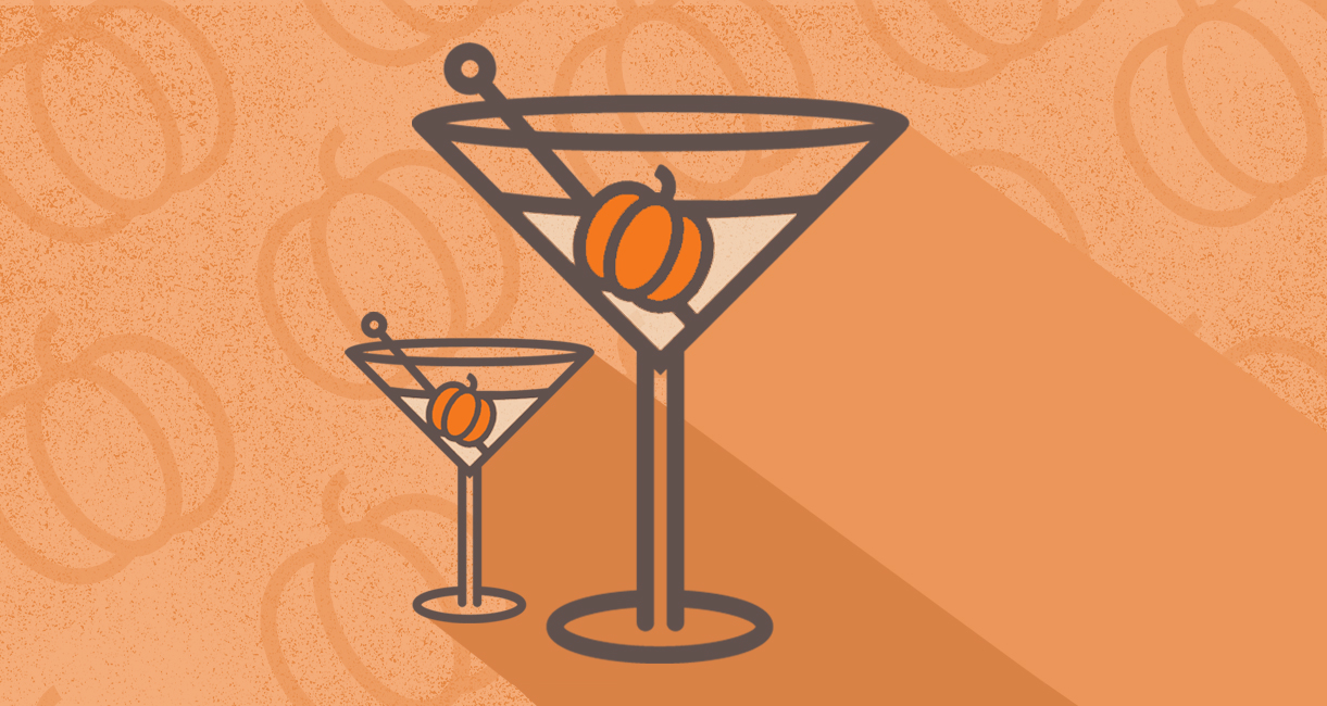two martini glasses with pumpkin garnishes