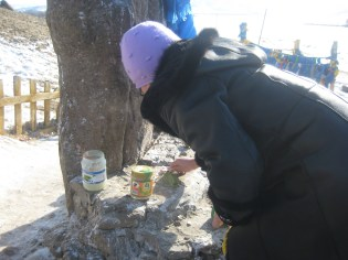 My director offering milk and incense at a religious site.