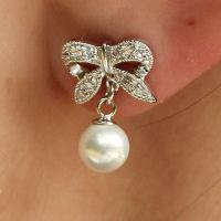 Sterling Silver Bow Earrings with Pearl Drop | Eve's ...