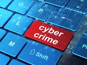 Safety concept: Cyber Crime on computer keyboard background