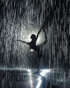 image of a woman doing a standing yoga pose in pouring rain
