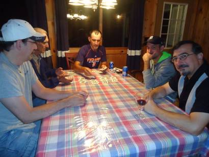My brothers and my dad playing euchre... making it an official trip to Michigan.