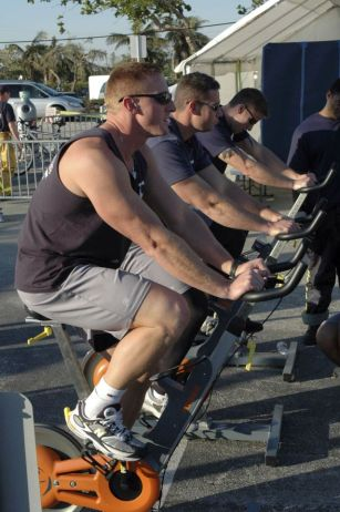 Soldiers riding stationary bikes