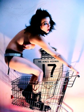 Girl riding shopping cart