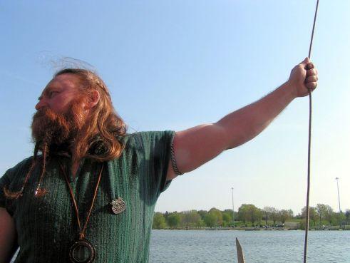 Viking man on longboat