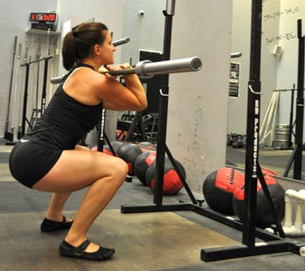 Woman exercising thighs with squats
