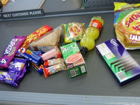 Junk food at supermarket checkout