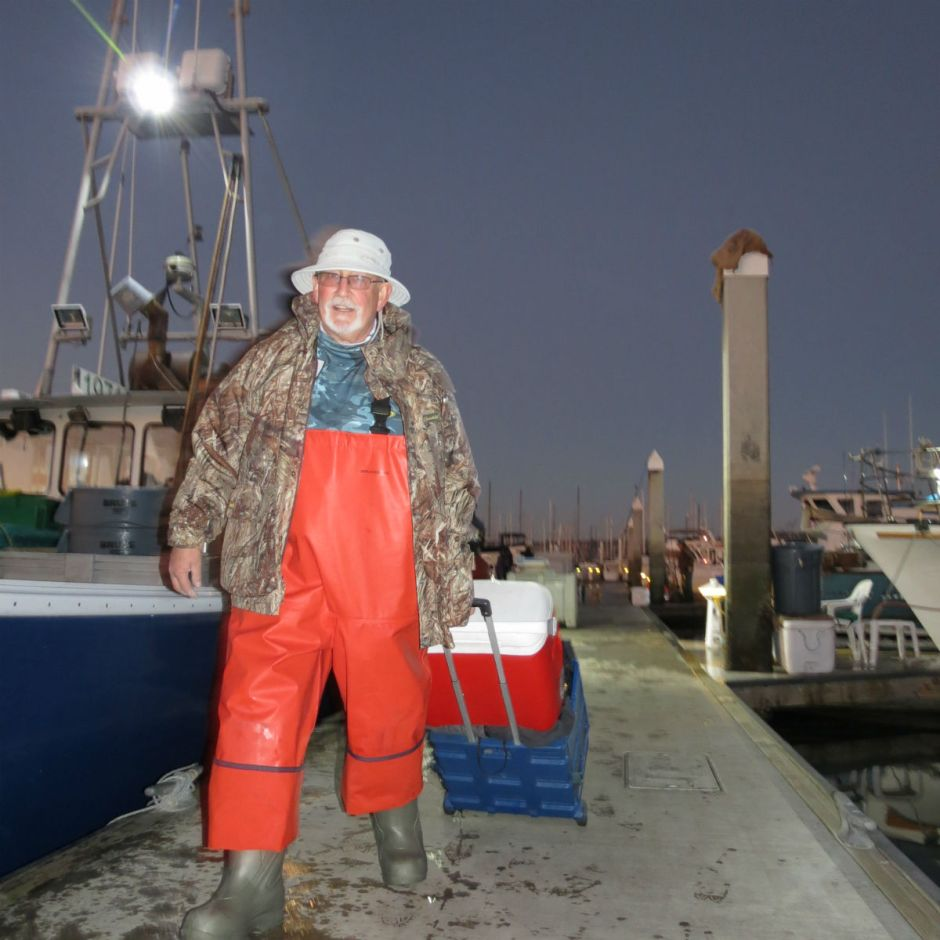 Dave Cornett of Chico hauls his live crabs up the dock in Emeryville.