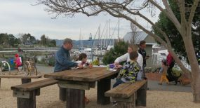 Picnickers enjoy the newly landscaped grounds.