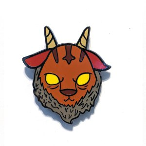 A photo of a enamel pin of a goat-devil mashup