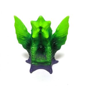 a bright green and purple elder thing vinyl toy
