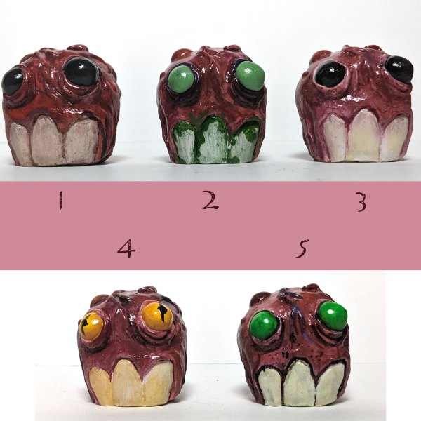 small sculptures of meat monster heads