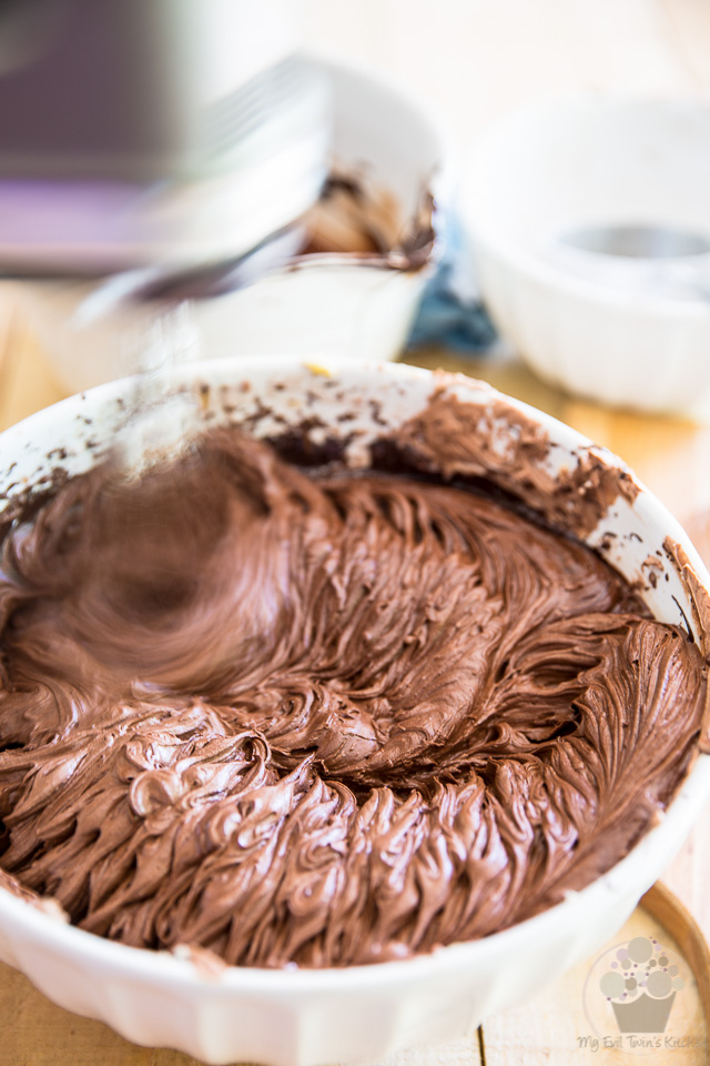 Beat the melted chocolate in - part of step by step instructions to make the most delicious Chocolate Fudge Frosting