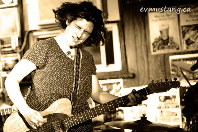image of jill staveley of the steelburners rocking out at the pig's ear tavern