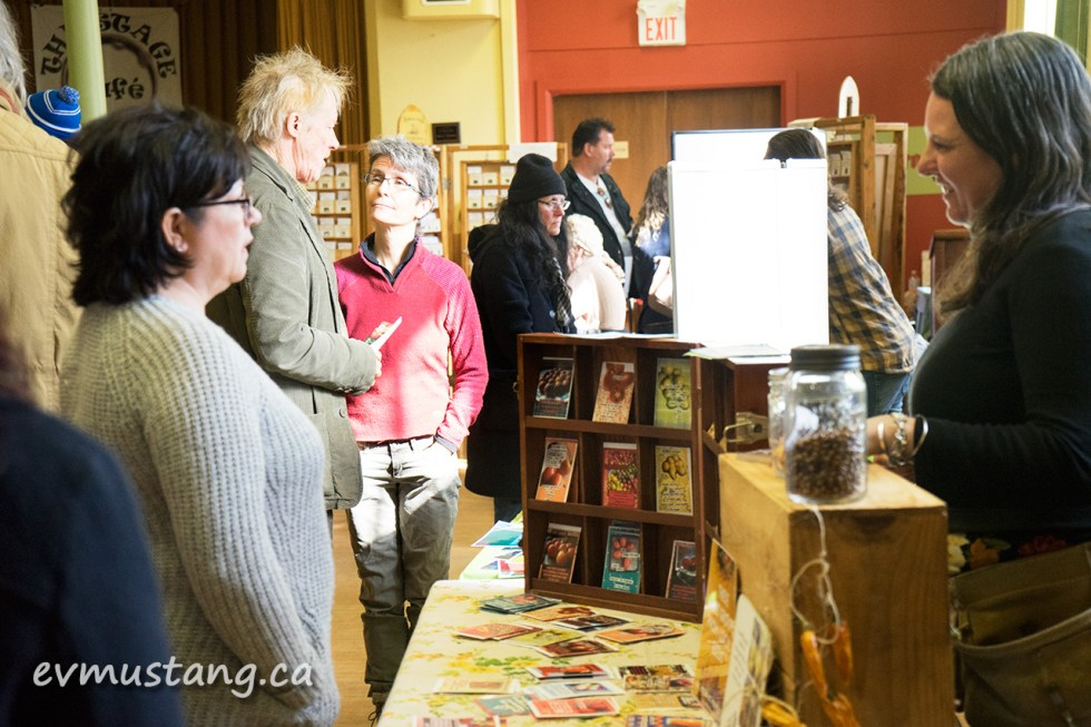 image of jill bishop behind her booth at peterborough's seedy sunday seed exchange