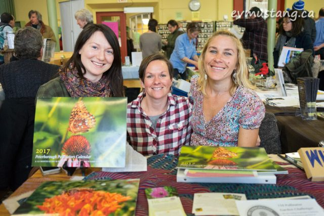 image of three attendees from peterborough polinators at their booth at seedy sundy
