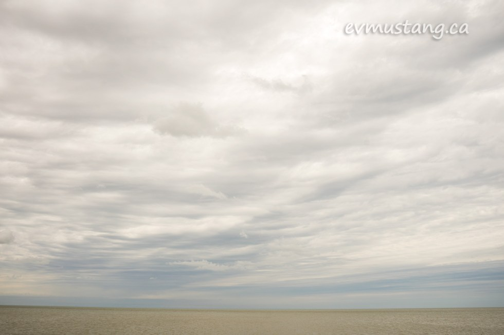 image of port burwell beach looking out over the water, the mottled clouds and water are the same tone