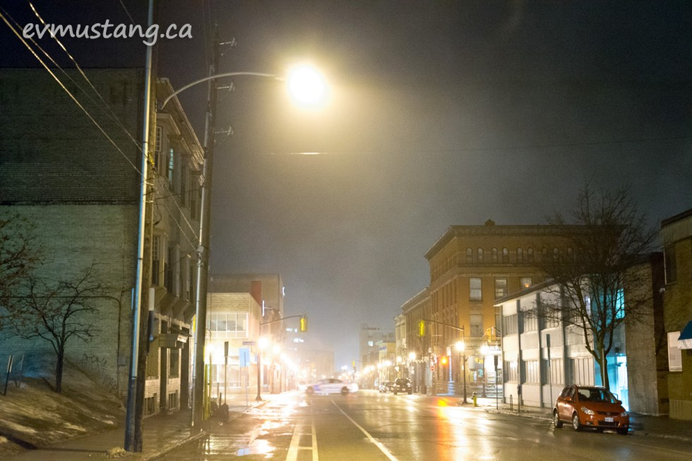 image of a police car blurily zipping through water and hunter streets in fog