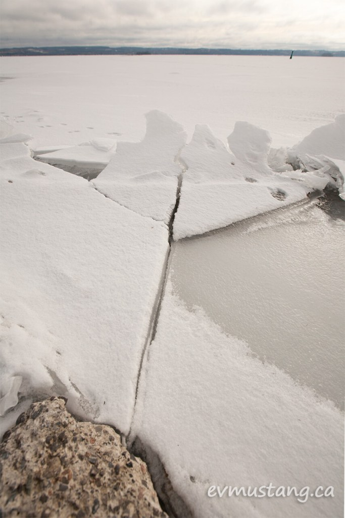 image of the edge of rice lake with granite and broken ice