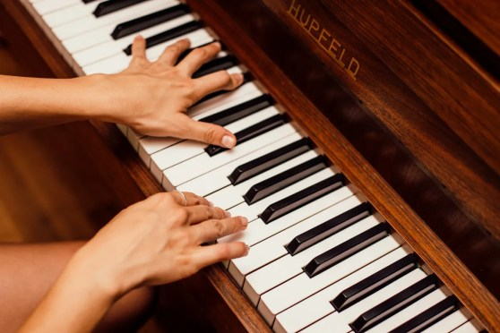 Close up of a person playing the piano - hire Texas movers when relocating locally if you own things like pianos