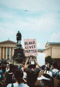 protest with Black Lives Matter sign raised
