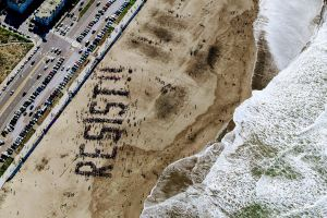 aerial view of protestors forming the message RESIST!!