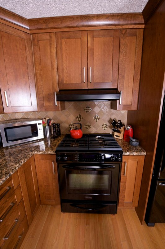 custom kitchen articulating faucet cabinets calgary evolve kitchens recycled wood