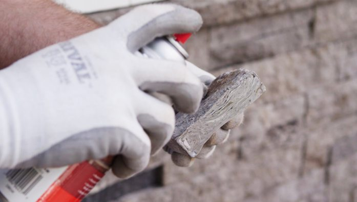 close up of person adding a WaterSeal to stone