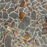 randomly shaped exterior stone with mortar between each creating a textured pattern with greys and browns
