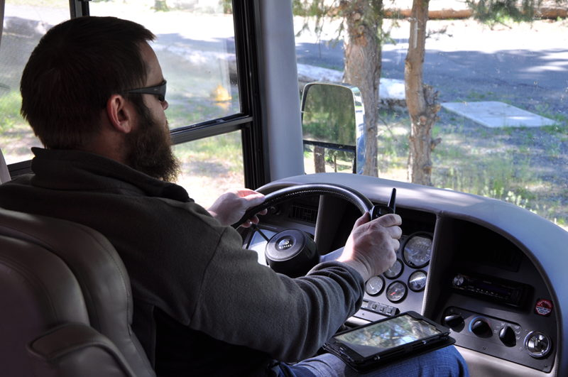 Adam driving with tablet and walkie talkie as navigation aids on our full time RV adventure.