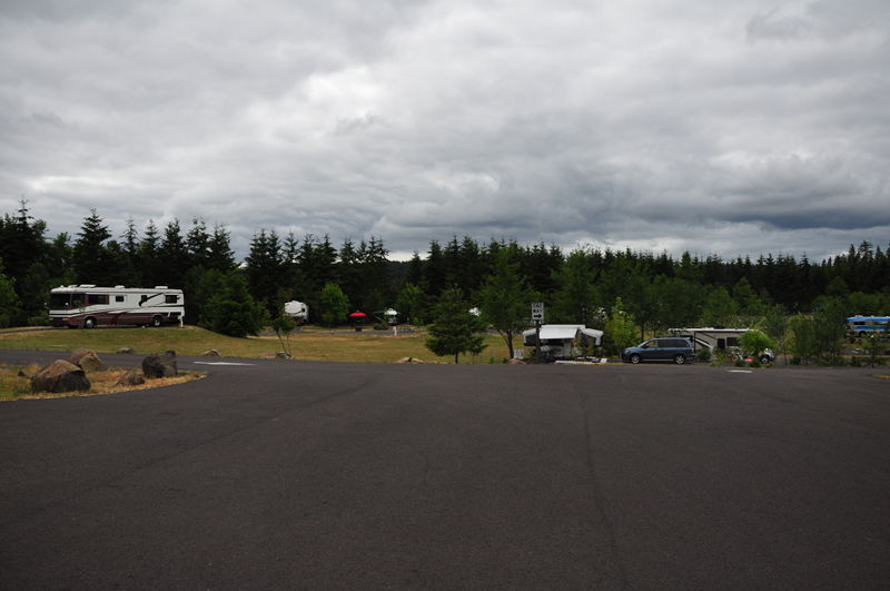 Entrance into Dairy Creek campground East at LL Stub Stewart State Park in Oregon with our RV in our site in the background as we live in it full time.