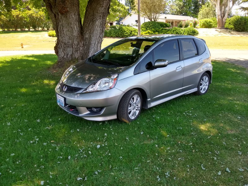 Our new Honda Fit tow car right after getting a wash while traveling full time around the country in our RV.