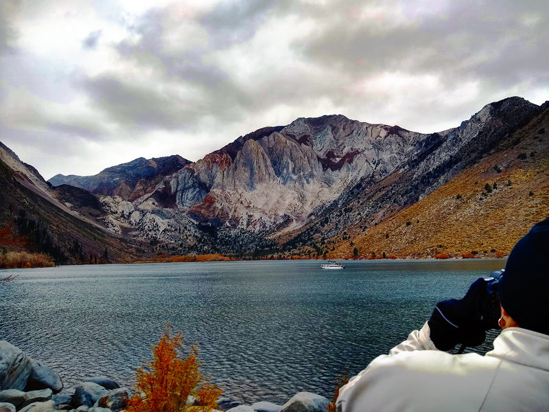 Adrianne taking a picture of Convict Lake in CA on our full time RV adventure.