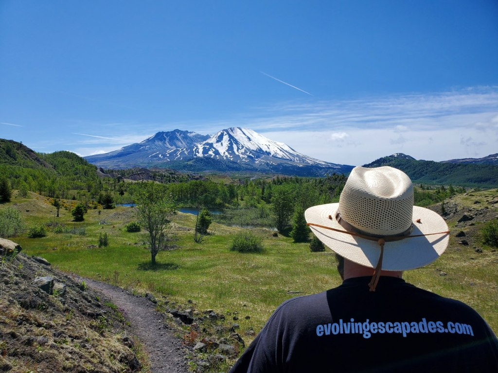 Adam is looking at Mt St. Helens while hiking the Boundary trail.