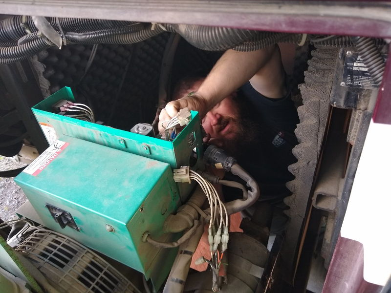 Adam attempting to repair the Onan generator in our Monaco Signature RV.