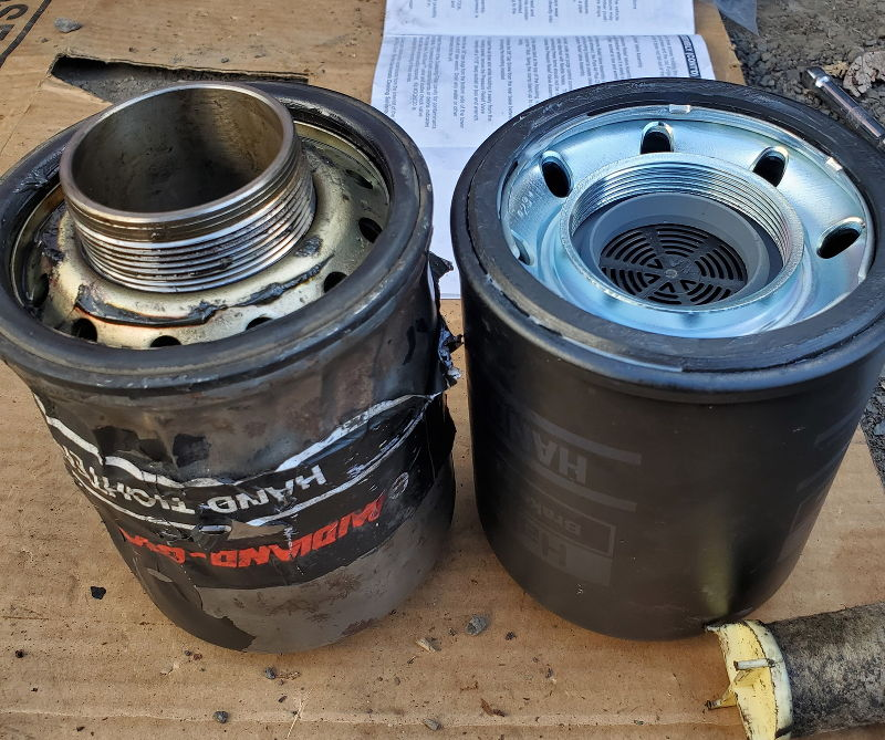 Picture of the olad and new air dryer filter side by side.