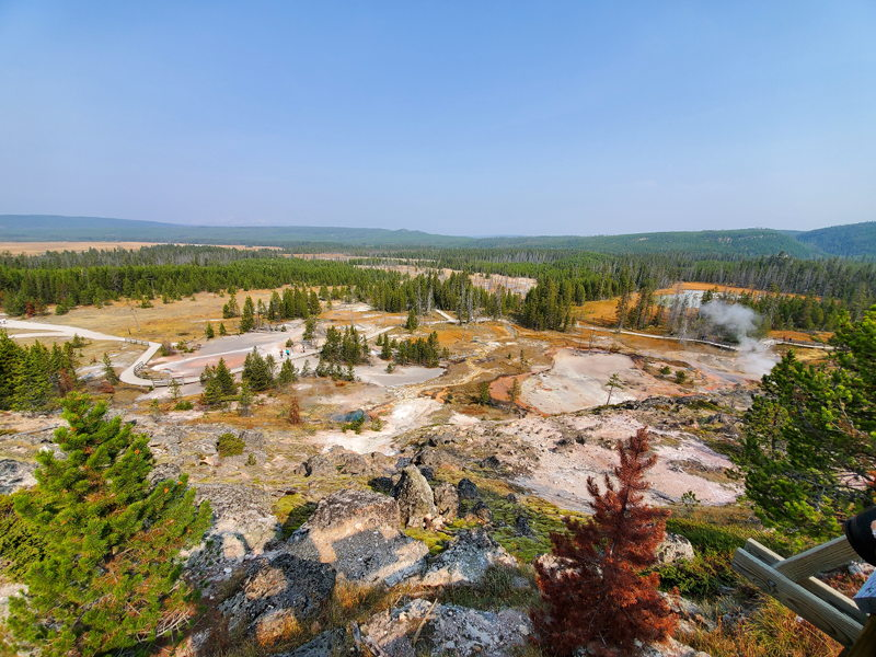 View from a cliff overlooking some hotsprings in Yellowstone.