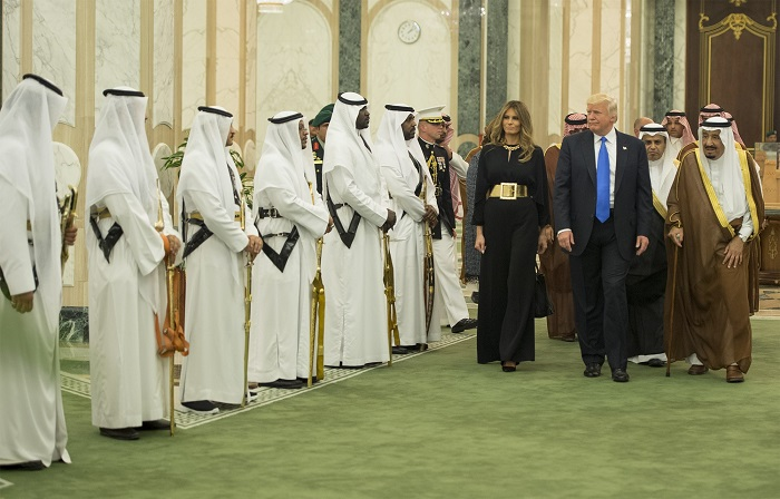 "RIYADH, SAUDI ARABIA - MAY 20: (----EDITORIAL USE ONLY MANDATORY CREDIT - ""BANDAR ALGALOUD / SAUDI ROYAL COUNCIL / HANDOUT"" - NO MARKETING NO ADVERTISING CAMPAIGNS - DISTRIBUTED AS A SERVICE TO CLIENTS----) Saudi Arabia's King Salman bin Abdulaziz Al Saud (R) welcomes U.S. President Donald Trump (right 2) and his wife Melania Trump (right 3) prior to their meeting at Al-Yamamah Palace in Riyadh, Saudi Arabia on May 20, 2017. (Photo by Bandar Algaloud / Saudi Royal Council / Handout/Anadolu Agency/Getty Images)"