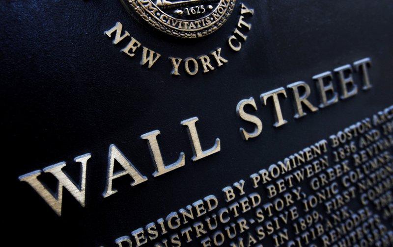 Tech stocks pull market sharply lower, erasing early gains