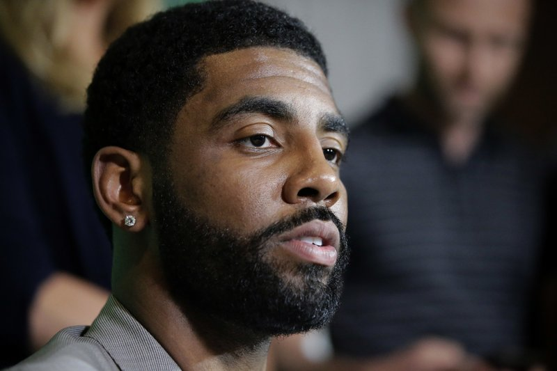 Irving stays busy with knee to mend, movie to promote